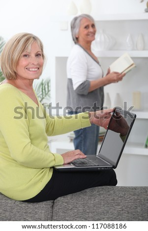 Older women with computer and book