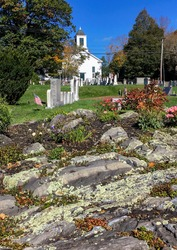 Oldest New England white wooden country church and cemetery in Kittery in autumn. One of the oldest churches in Maine. First Congregational church, established in 1714, in Kittery Point, ME.