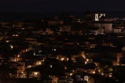 Olds streets of Toledo, Spain, illuminated by night. Toledo skyline.