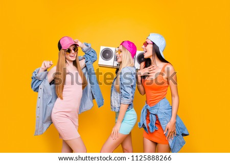 Oldschool culture portable lover fan cassette tape hip-hop rest relax leisure pleasure concept. Portrait of fancy trio enjoying favorite music dancing isolated on bright yellow background #1125888266