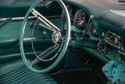 Oldtimer, green steering wheel and interior paneling
