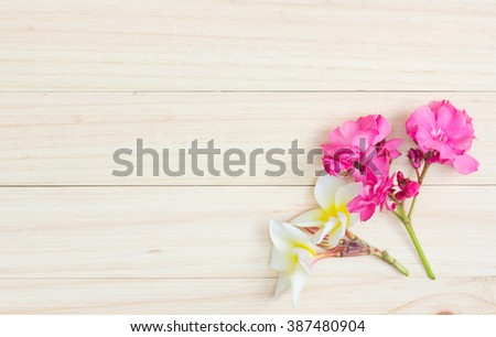 Oleander and Plumeria on wooden  , Top view of flowers on wooden table #387480904