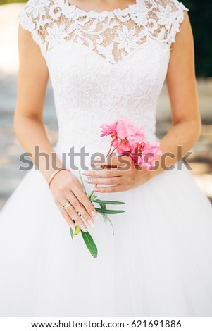 Oleander flower in the girl's hands. Wedding in Montenegro