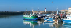 Oleron island in France, the typical harbor of the Cotiniere, with the lighthouse and fishing boats