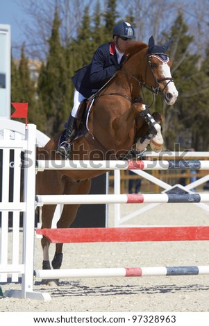 OLIVA, SPAIN - MARCH 10:  An unidentified competitor jumps with his horse at the MET Mediterranean Equestrian Tour on March 10, 2012, Oliva, Spain