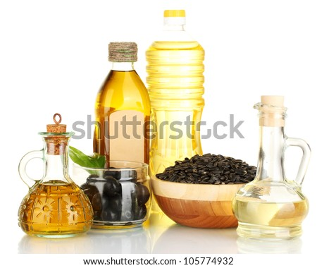 Olive and sunflower oil in the bottles and small decanters isolated on white