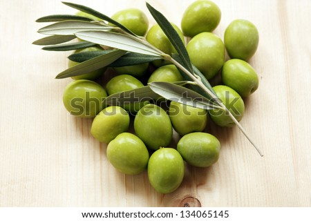 Olive branch and olive green in the shape of heart