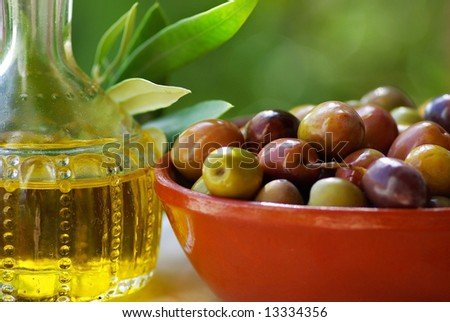 Olive oil and mature olives. - stock photo