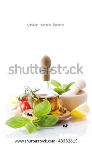 olive oil, basil and vegetables over white (with sample text)