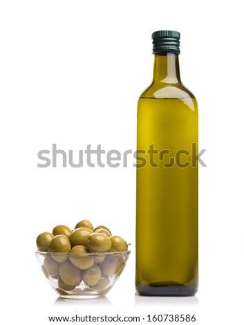 Olive oil bottle and olives on white background
