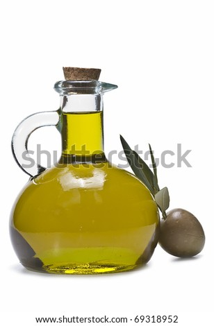 Olive oil bottle and two green olives with leaves isolated on a white background.