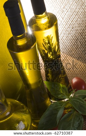 Olive oil bottle still-life over  textured background with back light