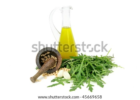 Olive oil, garlic,nuts in mortar and herbs.  Isolated on white background. - stock photo