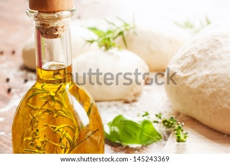 olive oil, herbs and pizza dough