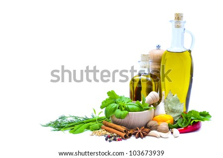 olive oil, herbs and spices isolated on a white background with copy space