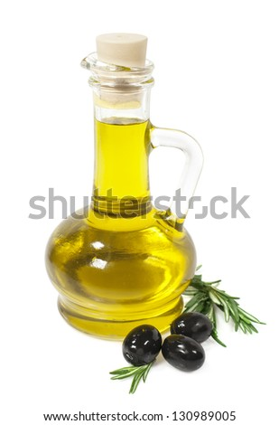 olive oil in a glass bottle with olives and rosemary