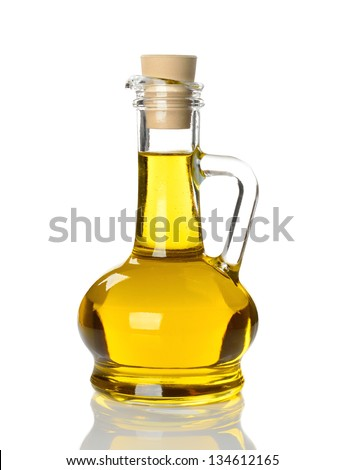 Olive oil in glass bottle isolated on white background