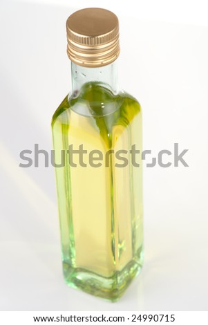 Olive oil in plain glass bottle, low contrast, limited focus