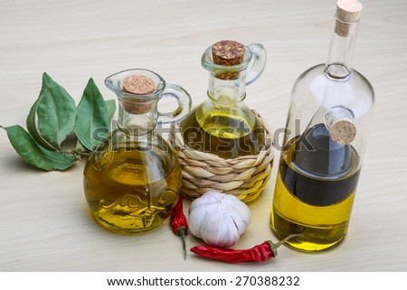 Olive oil in the bottles with laurel leaves