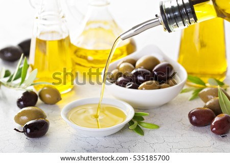 Olive oil in vintage bottles and small bowl #535185700