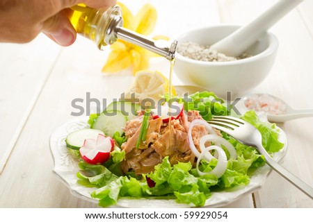 olive oil over tuna salad