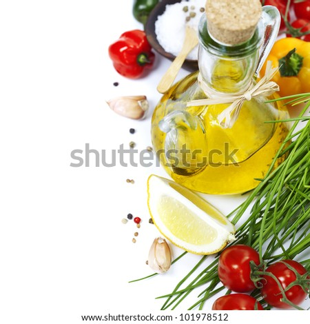 Olive oil, pepper, salt and  fresh vegetables, herbs and spices
