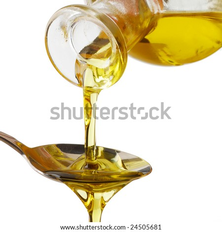 Olive oil poured into a spoon isolated on white background