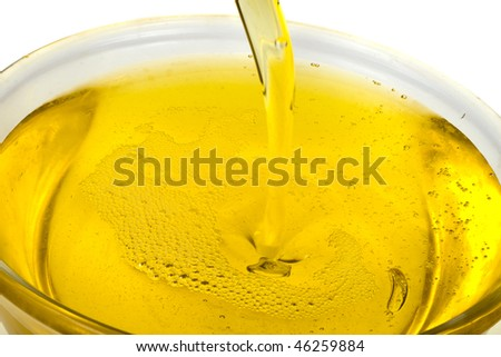 olive oil pouring  in bowl on white background