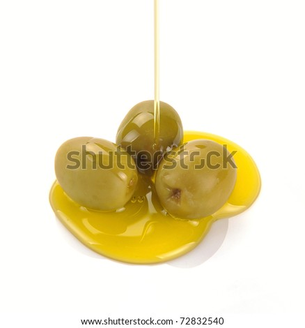 Olive oil pouring out. Pouring olive oil
