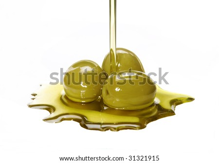Olive oil pouring out. Pouring olive oil. Olive oil.Olive oil concept.