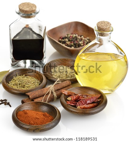 Olive Oil,Vinegar And Spices On White Background