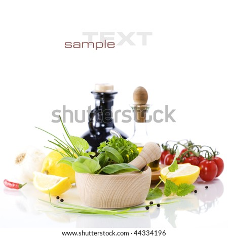 olive oil, vinegar, basil and vegetables over white (with sample text)