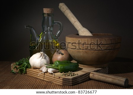 olive oil with garlic and onions on wooden board