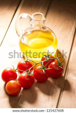 olive oil with tomatoes on wooden table