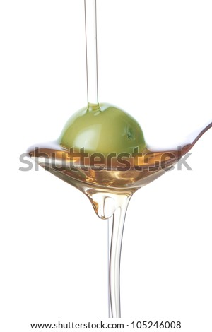 Olive on a spoon, spraying with oil.