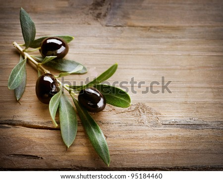 Olive over Wood Background - stock photo