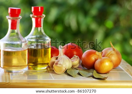 Oliveoil, vinegar and vegetables.