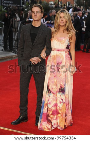 """Oliver Proudlock and Caggie Dunlop arriving for the """"Titanic 3D"""" premiere at the Royal Albert Hall, Kensington, London. 27/03/2012 Picture by: Steve Vas / Featureflash"""