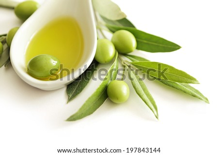 olives and olive oil on white background