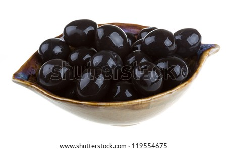 Olives black watered with olive oil in a bowl isolated on a white background