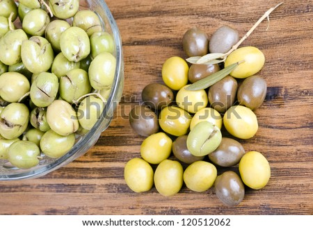 Olives in bowl and table