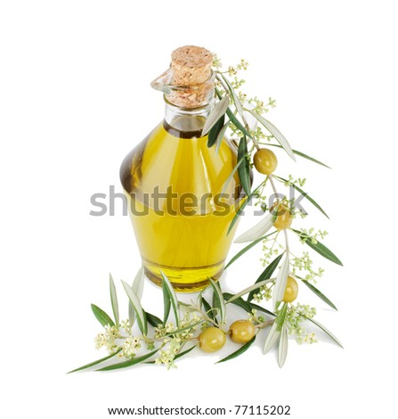 Olives, oil and a blossoming branch of an olive tree.  Isolated on a  white background.