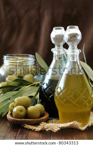 Olives , Olive Oil and balsamic vinegar on a wooden table