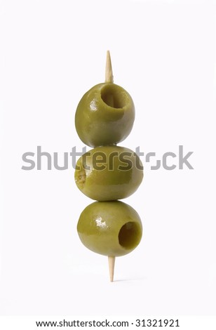 Olives on a toothpick. Three olives on white background.