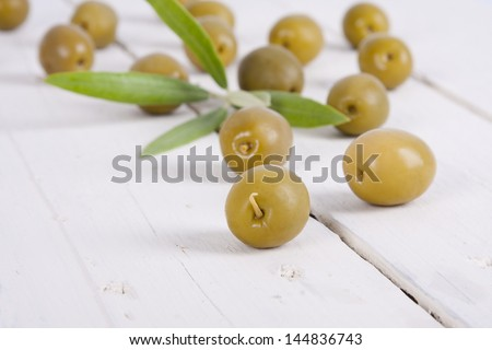 olives on wooden background white backgrounds food