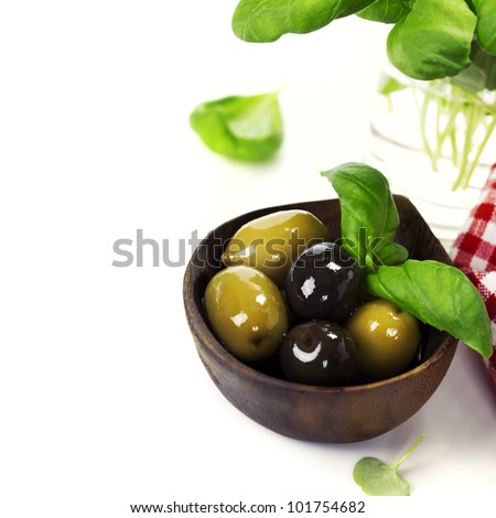 Olives  with basil and olive oil  over white