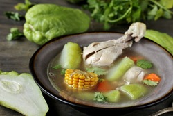Olla de Carne - Traditional Costa Rican Recipe. chicken soup and chayote, corn, carrots