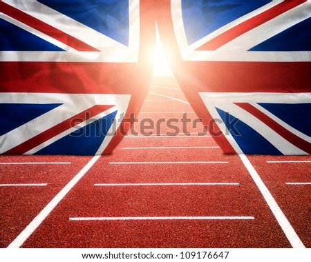 Olympics London concept with sun shining trough British flag curtains on running track