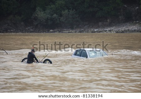 OLYMPOS, TURKEY - OCTOBER 14: A flood disaster has occurred on October 14, 2009 in Olympos, Turkey. The floods swept away about 50 cars and some bikes into the ocean. Divers are searching for victims