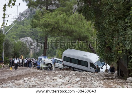 OLYMPOS, TURKEY - OCTOBER 14: Crashed cars and worried people after flood disaster on October 14, 2009 in Olympos, Turkey, Asia.